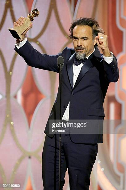 In this handout photo provided by NBCUniversal Alejandro G Inarritu accepts the award for Best Director Motion Picture for 'The Revenant' during the...