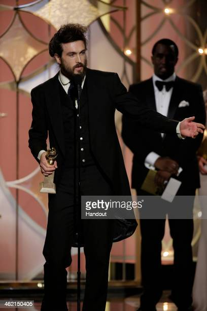 In this handout photo provided by NBCUniversal Alex Ebert accepts the award for Best Original Score Motion Picture for 'All is Lost' during the 71st...