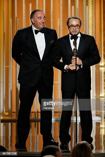 In this handout photo provided by NBCUniversal Alexander Rodnyansky and Andrey Zvyagintsev accept the award for Best Foreign Language Film for...