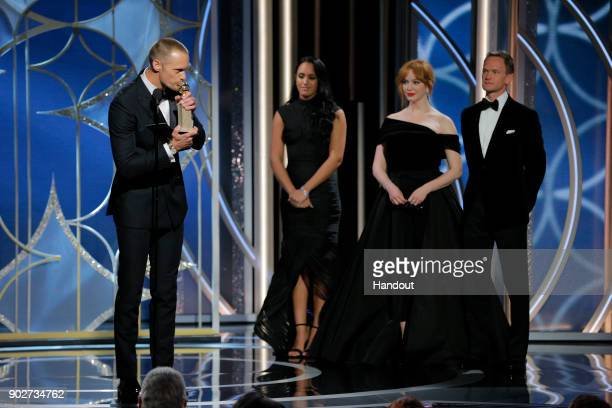 In this handout photo provided by NBCUniversal Alexander Skarsgård accepts the award for Best Performance by an Actor in a Supporting Role in a...