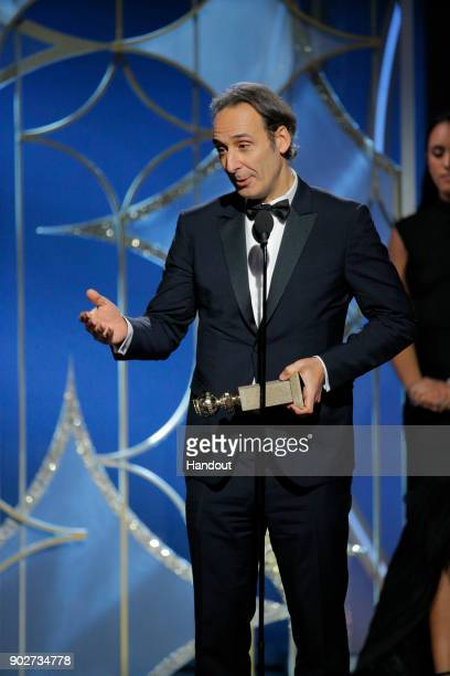 "In this handout photo provided by NBCUniversal Alexandre Desplat accepts the award for Best Original Score – Motion Picture for ""The Shape of Water""..."