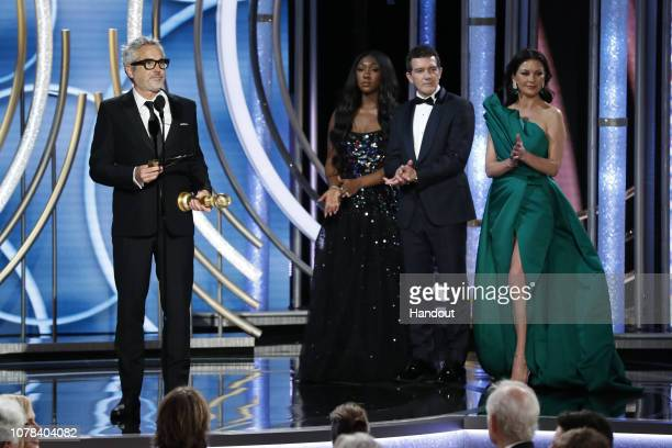 "In this handout photo provided by NBCUniversal Alfonso Cuaron of ""Roma"" accepts the Best Screenplay – Motion Picture award onstage during the 76th..."
