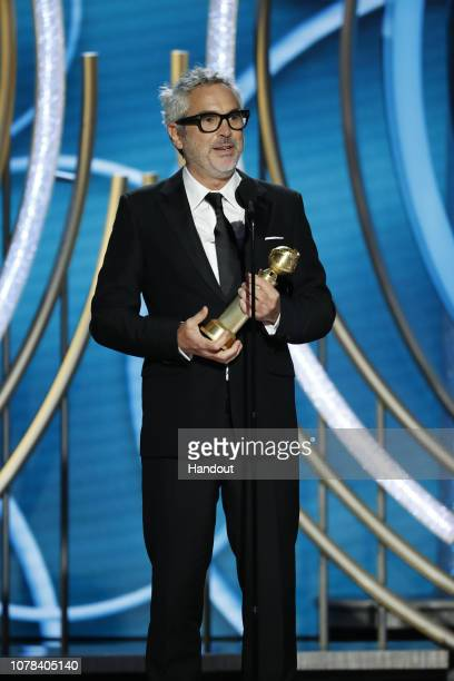 "In this handout photo provided by NBCUniversal Alfonso Cuaron of ""Roma"" accepts the Best Director – Motion Picture award onstage during the 76th..."