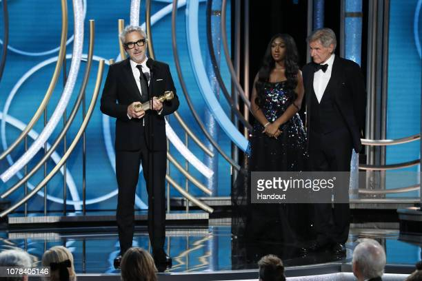 "In this handout photo provided by NBCUniversal, Alfonso Cuaron of ""Roma"" accepts the Best Director – Motion Picture award onstage during the 76th..."