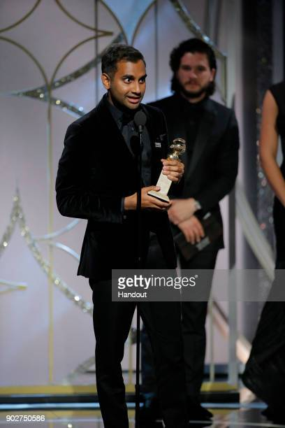 In this handout photo provided by NBCUniversal, Aziz Ansari accepts the award for Best Performance by an Actor in a Television Series – Musical or...