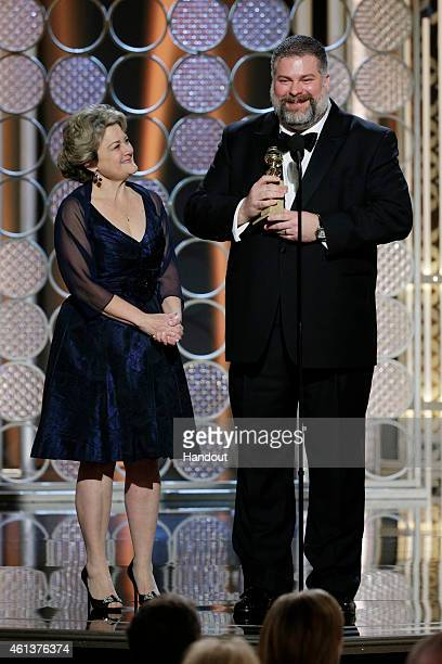 In this handout photo provided by NBCUniversal Bonnie Arnold and Dean DeBlois accept the award for Best Animated Feature Film for How to Train Your...