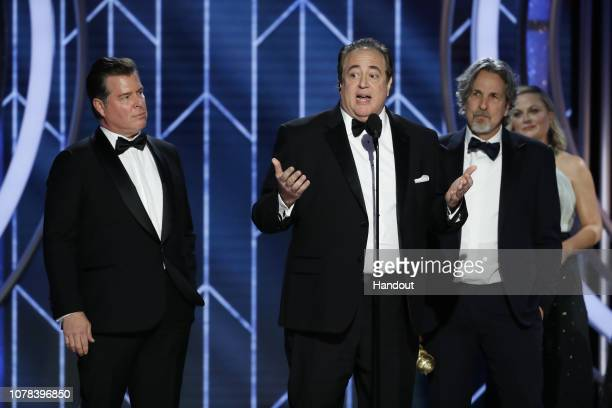 """In this handout photo provided by NBCUniversal Brian Currie Nick Vallelonga and Peter Farrelly of """"Green Book"""" accept the Best Screenplay – Motion..."""