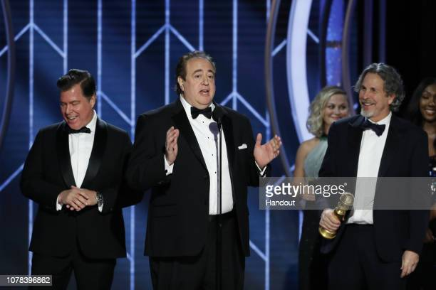 "In this handout photo provided by NBCUniversal Brian Currie Nick Vallelonga and Peter Farrelly of ""Green Book"" accept the Best Screenplay – Motion..."