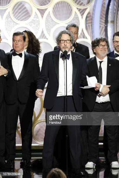 """In this handout photo provided by NBCUniversal Brian Hayes Currie Peter Farrelly and Charles B Wessler from """"Green Book"""" accept the Best Motion..."""