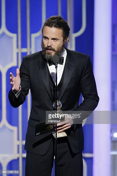 In this handout photo provided by NBCUniversal Casey Affleck accepts the award for Best Actor in a Motion Picture Drama for his role in 'Manchester...
