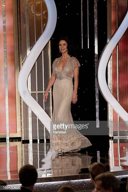 In this handout photo provided by NBCUniversal Catherine ZetaJones on stage to present during the 70th Annual Golden Globe Awards at the Beverly...