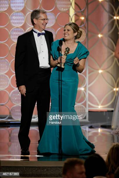 In this handout photo provided by NBCUniversal Chris Buck and Jennifer Lee accept the award for Best Animated Feature Film for Frozen during the 71st...