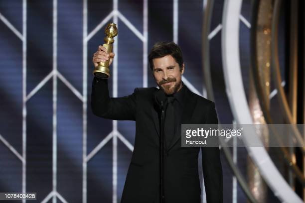 "In this handout photo provided by NBCUniversal, Christian Bale from ""Vice"" accepts the Best Actor in a Motion Picture – Musical or Comedy award..."