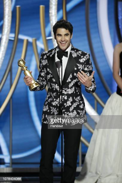 "In this handout photo provided by NBCUniversal Darren Criss from ""The Assassination of Gianni Versace American Crime Story"" accepts the Best..."