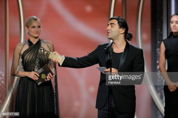 In this handout photo provided by NBCUniversal Director Fatih Akin with actress Diane Kruger accepts the award for Best Motion Picture – Foreign...