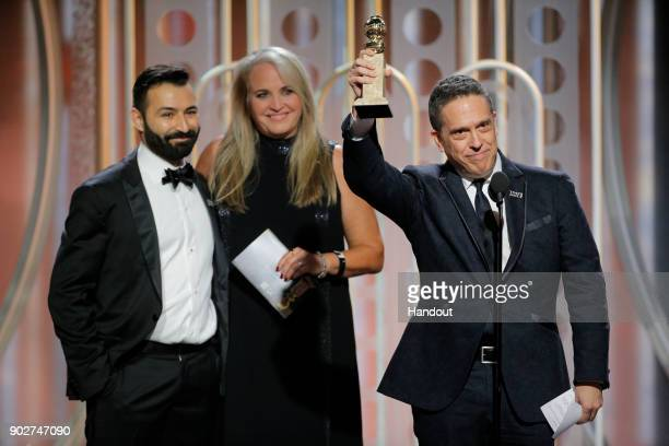 In this handout photo provided by NBCUniversal Director Lee Unkrich accepts the award for Best Animated Film for Coco during the 75th Annual Golden...