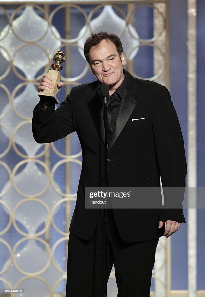 In this handout photo provided by NBCUniversal, Director Quentin Tarantino accepts the Best Screenplay award for Motion Picture, 'Django Unchained' on stage during the 70th Annual Golden Globe Awards at the Beverly Hilton Hotel International Ballroom on January 13, 2013 in Beverly Hills, California.