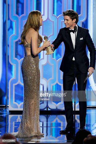 In this handout photo provided by NBCUniversal Eddie Redmayne presents Brie Larson with the award for Best Actress Motion Picture Drama for 'Room'...