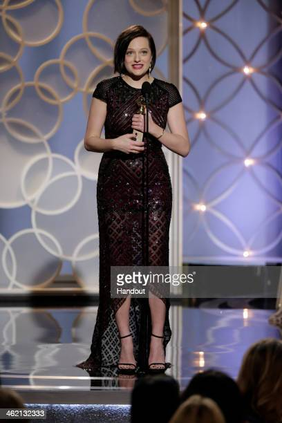 In this handout photo provided by NBCUniversal Elisabeth Moss accepts the award for Best Actress MiniSeries or TV Movie for Top of the Lake during...