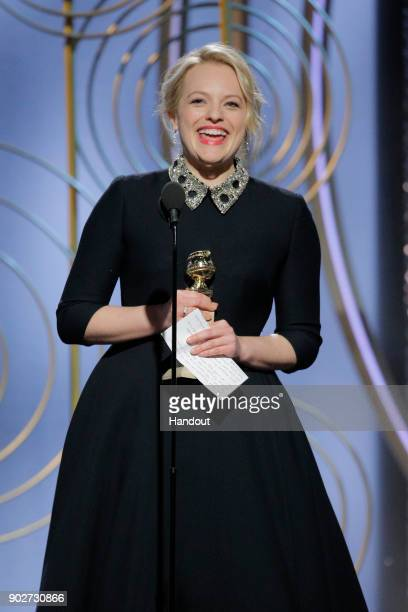 In this handout photo provided by NBCUniversal Elisabeth Moss accepts the award for Best Performance by an Actress in a Television Series – Drama for...