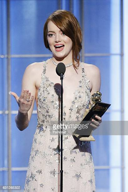In this handout photo provided by NBCUniversal Emma Stone accepts the award for Best Actress in a Motion Picture Musical or Comedy for her role in...