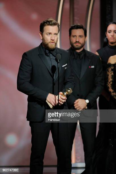 In this handout photo provided by NBCUniversal Ewan McGregor accepts the award for Best Performance by an Actor in a Limited Series or Motion Picture...
