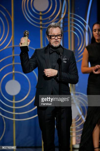 In this handout photo provided by NBCUniversal Gary Oldman accepts the award for Best Performance by an Actor in a Motion Picture – Drama for...