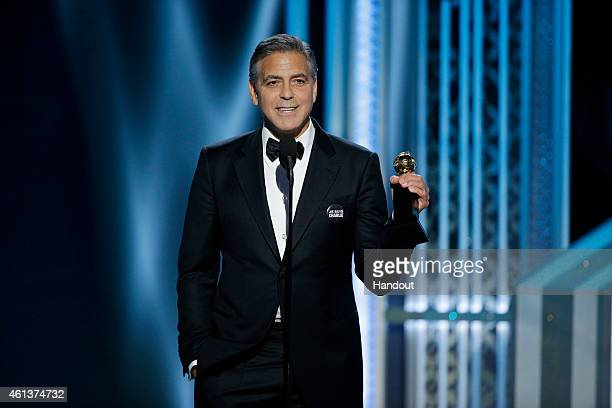 In this handout photo provided by NBCUniversal George Clooney Winner of the Cecile B Demille Award speaks onstage during the 72nd Annual Golden Globe...