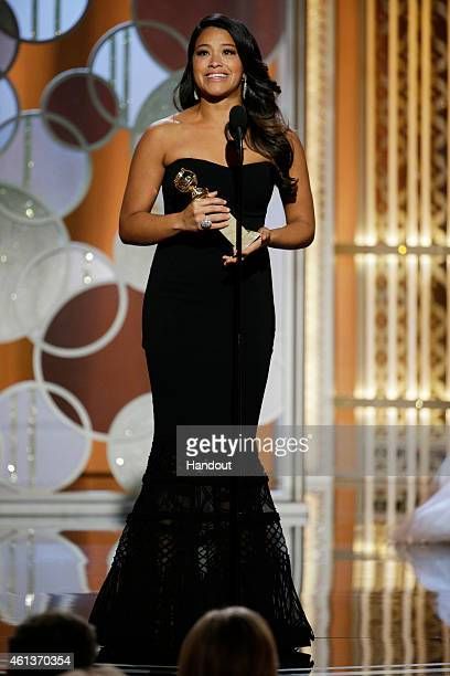 In this handout photo provided by NBCUniversal Gina Rodriguez Winner of Best Actress TV Series Comedy or Musical for 'Jane the Virgin' speaks onstage...