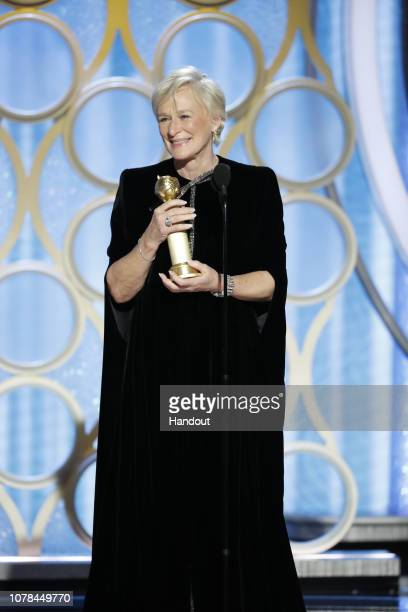 "In this handout photo provided by NBCUniversal Glenn Close from ""The Wife"" accepts the Best Actress in a Motion Picture – Drama award onstage during..."