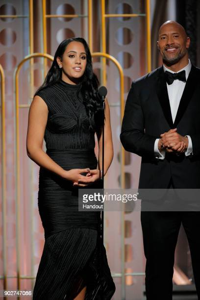 In this handout photo provided by NBCUniversal Golden Globe Ambassador Simone Garcia Johnson and Dwayne Johnson speak onstage during the 75th Annual...