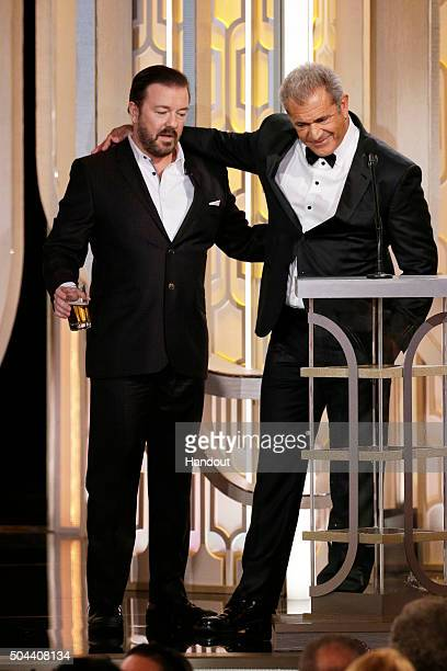 In this handout photo provided by NBCUniversal Host Ricky Gervais and presenter Mel Gibson speak onstage during the 73rd Annual Golden Globe Awards...