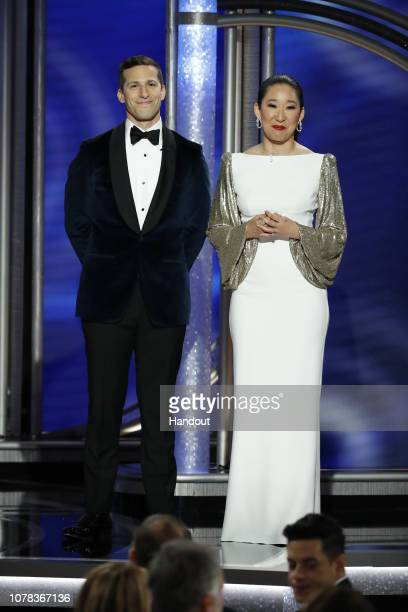 In this handout photo provided by NBCUniversal, Hosts Andy Samberg and Sandra Oh speak onstage during the 76th Annual Golden Globe Awards at The...
