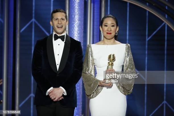 In this handout photo provided by NBCUniversal Hosts Andy Samberg and Sandra Oh speak onstage during the 76th Annual Golden Globe Awards at The...