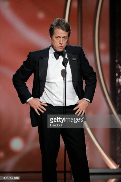 In this handout photo provided by NBCUniversal Hugh Grant speaks onstage during the 75th Annual Golden Globe Awards at The Beverly Hilton Hotel on...