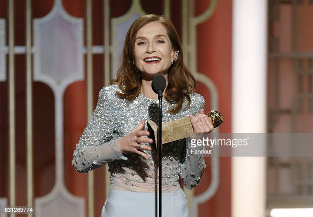 In this handout photo provided by NBCUniversal Isabelle Huppert accepts the award for Best Actress in a Motion Picture Drama for her role in 'Elle'...