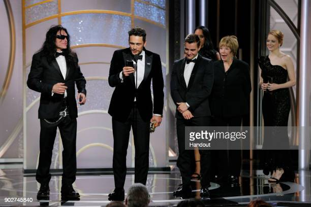 In this handout photo provided by NBCUniversal James Franco with Tommy Wiseau and Dave Franco accepts the award for Best Performance by an Actor in a...