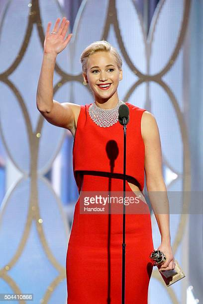 In this handout photo provided by NBCUniversal Jennifer Lawrence accepts the award for Best Actress Motion Picture Comedy for 'Joy' onstage during...