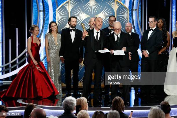 "In this handout photo provided by NBCUniversal Joe Weinberg from ""The Americans"" accept the Best Television Series – Drama award onstage during the..."