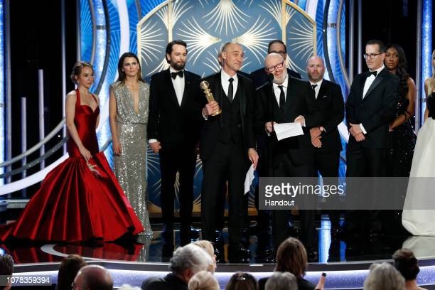 "In this handout photo provided by NBCUniversal, Joe Weinberg from ""The Americans"" accept the Best Television Series – Drama award onstage during the..."