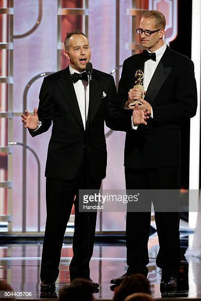 In this handout photo provided by NBCUniversal Jonas Rivera and Pete Docter accept the award for Best Motion Picture Animated for Inside Out during...