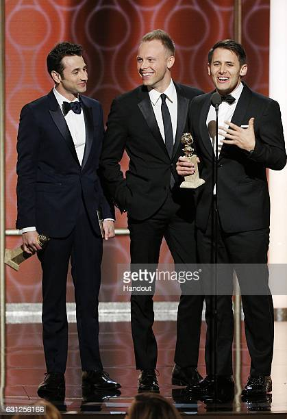In this handout photo provided by NBCUniversal Justin Hurwitz Benj Pasek and Justin Paul accept the award for Best Original Song Motion Picture for...