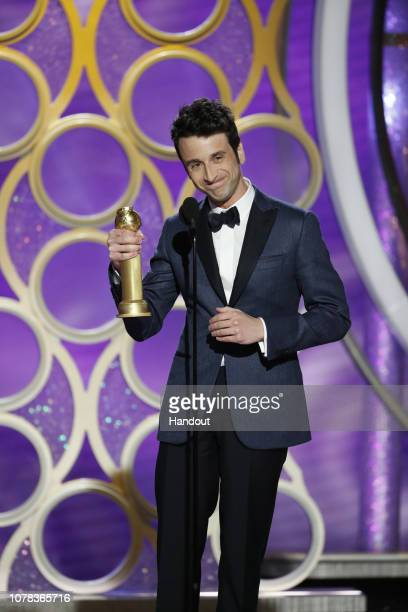 """In this handout photo provided by NBCUniversal Justin Hurwitz from """"First Man"""" accepts the Best Original Score Motion Picture award onstage during..."""