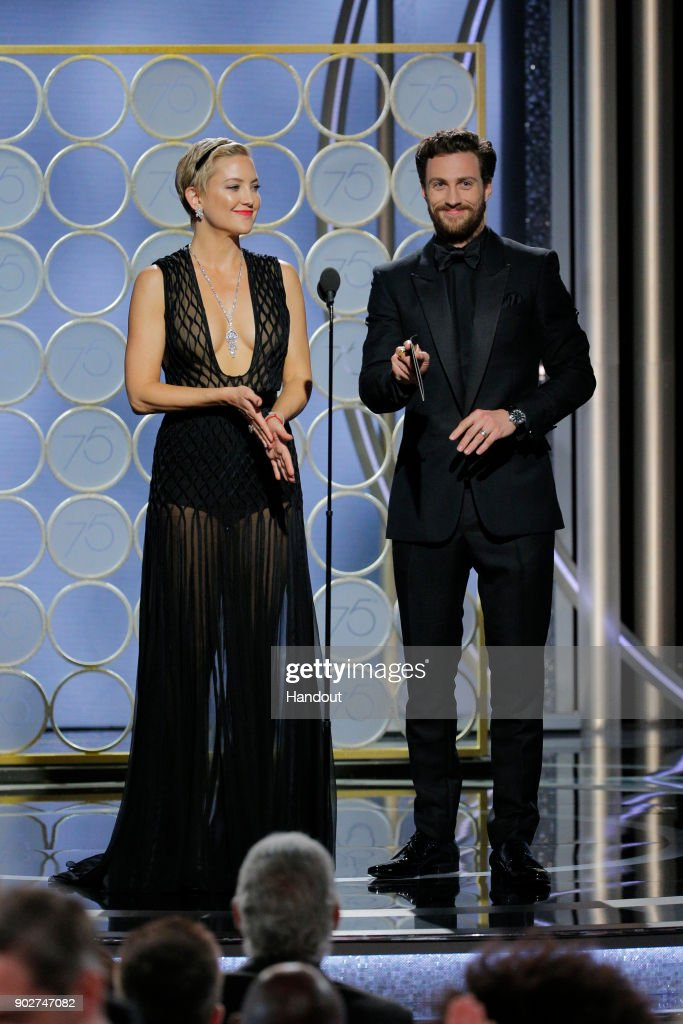 In this handout photo provided by NBCUniversal, Kate Hudson and Aaron Taylor Johnson speak onstage during the 75th Annual Golden Globe Awards at The Beverly Hilton Hotel on January 7, 2018 in Beverly Hills, California.