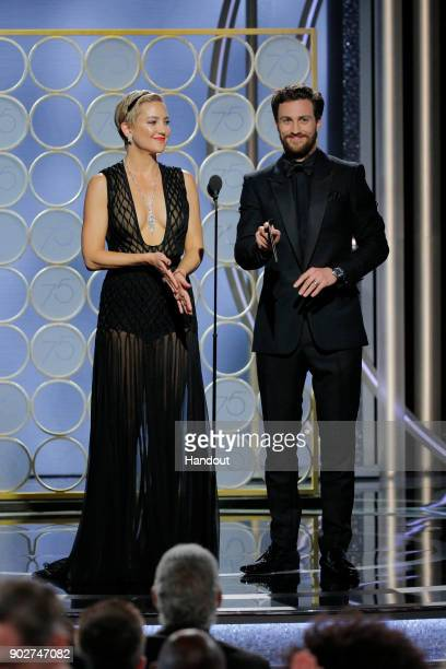 In this handout photo provided by NBCUniversal Kate Hudson and Aaron Taylor Johnson speak onstage during the 75th Annual Golden Globe Awards at The...