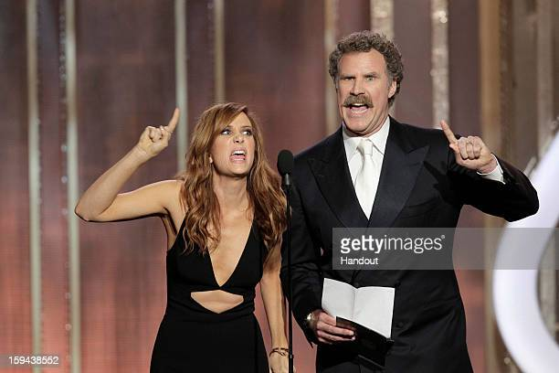 In this handout photo provided by NBCUniversal, Kristen Wiig and Will Ferrell on stage to present the Best Actress - Motion Picture, Comedy or...