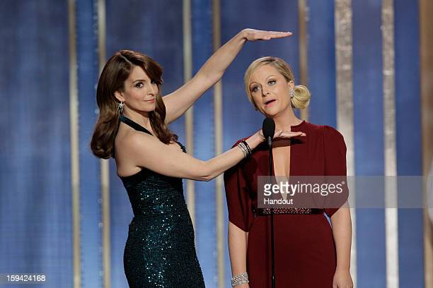In this handout photo provided by NBCUniversal, L to R Tina Fey and Amy Poehler host the 70th Annual Golden Globe Awards at the Beverly Hilton Hotel...
