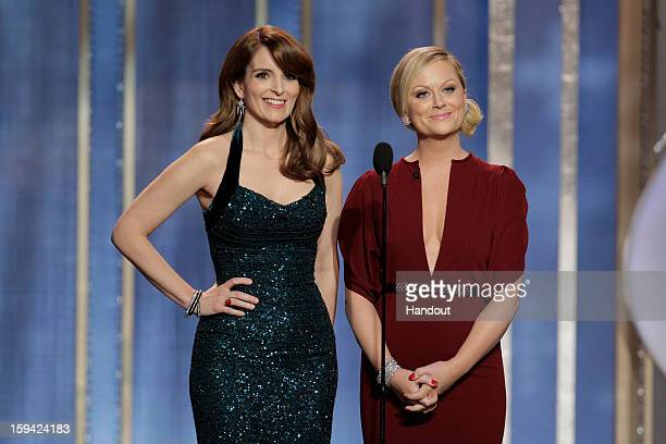 In this handout photo provided by NBCUniversal L to R Tina Fey and Amy Poehler host the 70th Annual Golden Globe Awards at the Beverly Hilton Hotel...