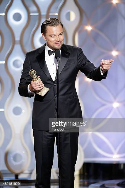 In this handout photo provided by NBCUniversal Leonardo DiCaprio accepts the award for Best Actor Motion Picture Comedy or Musical for 'The Wolf of...