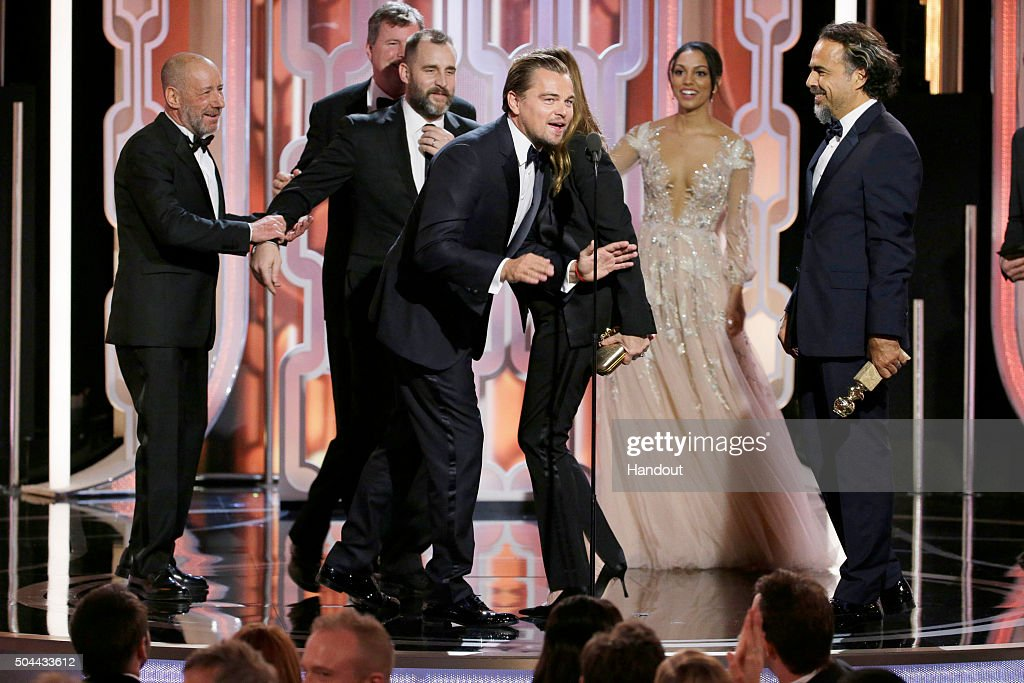 In this handout photo provided by NBCUniversal, Leonardo DiCaprio accepts the award for Best Motion Picture, Drama for 'The Revenant' during the 73rd Annual Golden Globe Awards at The Beverly Hilton Hotel on January 10, 2016 in Beverly Hills, California.